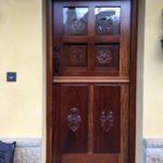 Puerta de entrada cuarteron madera tallada